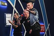 Nathan Aspinall reacts to hitting a 180 during the World Darts Championships 2018 at Alexandra Palace, London, United Kingdom on 30 December 2018.