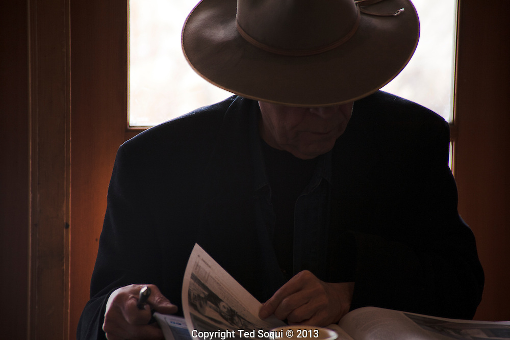 Winter in New Mexico.. A man in a hat having coffee in a Santa Fe coffee shop.