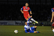 Gillingham's Joe Martin © is tackled by Bristol Rovers player Ollie Norburn (on ground). NPower league two match, Bristol Rovers v Gillingham at the Memorial stadium in Bristol on Saturday 5th Jan 2013. pic by Andrew Orchard, Andrew Orchard sports photography,
