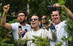 """Organiser Danny Tommo, centre,  is seen in Cavendish Square taunting anti-fascist counter protesters as several hundred protesters gather in central London demanding the release of """"political prisoner"""" right wing talisman Stephen Yaxley-Lennon  - also known as Tommy Robinson, who was imprisoned for contempt of court. London, August 03 2019."""