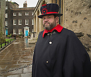 Beefeater guard at the Tower of London. Amiable chap who likes his job but says it's hard on his legs and knees.