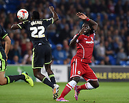Kenwyne Jones of Cardiff city ®  challenges Middlesbrough's Kenneth Omeruo (22) .Skybet football league championship match, Cardiff city v Middlesbrough at the Cardiff city stadium in Cardiff, South Wales on Tuesday 16th Sept 2014<br /> pic by Andrew Orchard, Andrew Orchard sports photography.