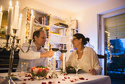 Couple toasting with wineglasses on candlelight dinner