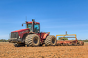 Case 485HD tractor and plough in ploughed field <br /> <br /> Editions:- Open Edition Print / Stock Image