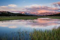 Sunset over flooded tuolumne meadows in summer, Yosemite national park, California, USA