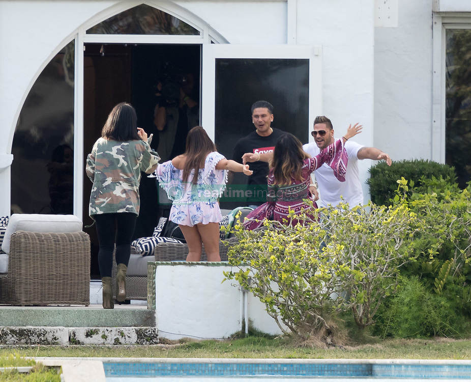 """EXCLUSIVE: Snooki, Jenni JWoww Farley, DJ Pauly D, Vinny Guadagnino and friends looked not to have a care in the world as they sipped sangria and chilled out at the rear of their luxury waterfront rented house on South Beach. They were heard loudly cheering and toasting each other, while at a Federal court in Newark, Sorrentino was pleading guilty to cheating on his taxes regarding multiple counts related to nearly $9 million in income from the show. It is not known whether 'The Situation,' who appeared in all six seasons of the MTV reality show, will be joining his former rowdy housemates in Florida, where they're about to start filming Jersey Shore Family Vacation. Sorrentino and his brother/manager Marc were charged in 2014 and again last year with multiple counts related to nearly $9 million in income from the show. On Friday, the reality star pleaded guilty to one count of tax evasion and admitted concealing his income in 2011 by making cash deposits in amounts that wouldn't trigger federal reporting requirements. Sentencing was scheduled for late April. 19 Jan 2018 Pictured: Nicole """"Snooki"""" Polizzi, Jennifer Lynn """"Jenni"""" Farley """"JWoww"""", Deena Nicole Cortese. """"Pauly D"""" DelVecchio, Ronnie Ortiz-Magro. Photo credit: Splash/MEGA TheMegaAgency.com +1 888 505 6342"""