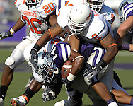Oklahoma State linebacker Rodrick Johnson (2) wraps up Kansas State running back Leon Patton (14) in the second half at Bill Snyder Family Stadium in Manhattan, Kansas, October 7, 2006.  The Wildcats beat the Cowboys 31-27.<br />
