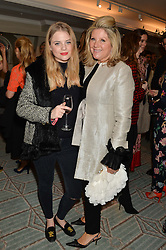 Left to right, BEA FRESSON and her mother SERENA FRESSON at the launch of Mrs Alice in Her Palace - a fashion retail website, held at Fortnum & Mason, Piccadilly, London on 27th March 2014.