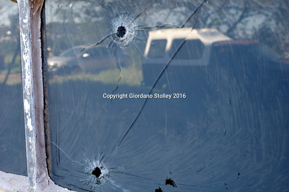 DURBAN - 13 May 2016 - An abandoned bakkie reflects in a window that has three bullet holes in Durban's notorious Gelebelands Hostels. Hundreds of police officers from Durban, the KwaZulu-Natal south coast, Pretoria and the eThekwini Metro Police forces converged on the violent Glebelands Hostels on the edge of Durban's Umlazi township, which have seen numerous shootings that have leftt at least 61 people dead and scores injured. Picture: Allied Picture Press/APP