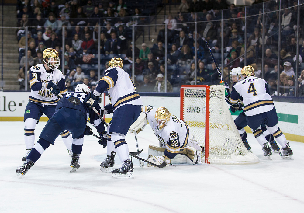 March 10, 2018:  Notre Dame goaltender Cale Morris (32) makes the save on shot by Penn State forward Andrew Sturtz (16) during NCAA Hockey game action between the Notre Dame Fighting Irish and the Penn State Nittany Lions at Compton Family Ice Arena in South Bend, Indiana.  Notre Dame defeated Penn State 3-2.  John Mersits/CSM