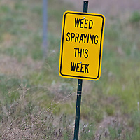 A sign warns hikers of invasive noxious weed spraying in the Rattlesnake Recreation Area north of Missoula, Montana.