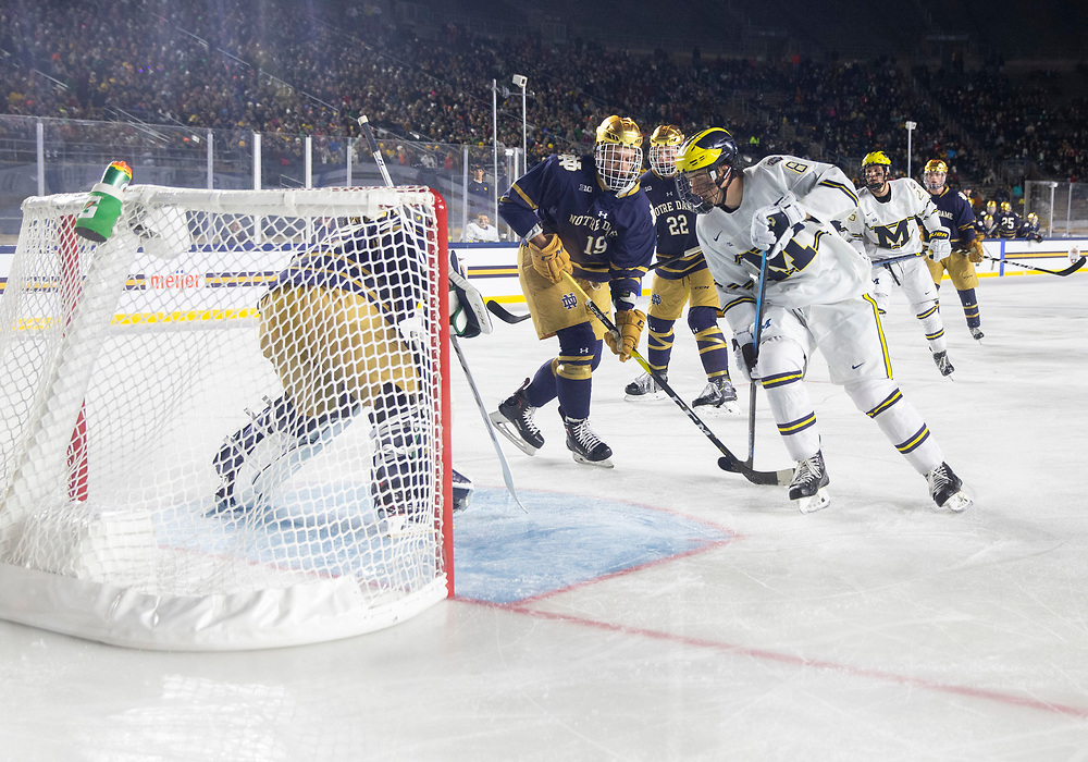January 05, 2019:  A general view as Notre Dame goaltender Cale Morris (32) makes the save during NCAA Hockey game action between the Michigan Wolverines and the Notre Dame Fighting Irish at Notre Dame Stadium in South Bend, Indiana.  Michigan defeated Notre Dame 4-2.  John Mersits/CSM