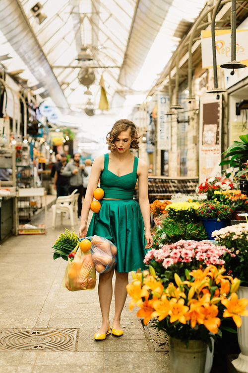 A model acts for a PR film, at the Mahane Yehuda Market in Jerusalem