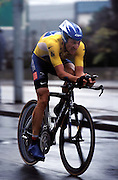 Lance Armstrong powers through the rain in Nantes as he nears the end of the final Time Trial of the 2004 Tour de France.
