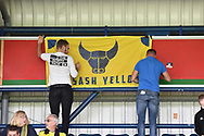 Oxford United fans put up their colours during the EFL Sky Bet League 1 match between Wycombe Wanderers and Oxford United at Adams Park, High Wycombe, England on 15 September 2018.