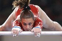 Arkansas gymnast Kim Harris performs her uneven bars routine during the inaugural season of the Lady Razorback gymnastics team.