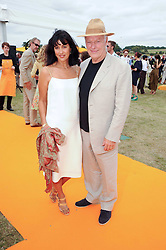POLLY SAMSON and DAVID GILMOUR at the Veuve Clicquot Gold Cup polo final held at Cowdray Park, Midhurst, West Sussex on 18th July 2010.