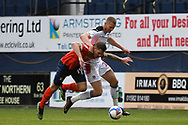 Luton Town Forward James Collins (19)  and Rotherham United Forward Michael Smith (24)  battles for possession during the EFL Sky Bet Championship match between Luton Town and Rotherham United at Kenilworth Road, Luton, England on 4 May 2021.