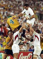 Photo. Steve Holland. England v Australia Final at the Telstra Stadium, Sydney. RWC 2003.<br />22/11/2003.<br />Martin Johnston jumps in the line out