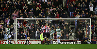 Photo: Andrew Unwin.<br />Sunderland v Northwich Victoria. The FA Cup. 08/01/2006.<br />Sunderland's Anthony Le Tallec (L) celebrates scoring his team's third goal with Julio Arca (R) as Northwich Victoria look dejected.