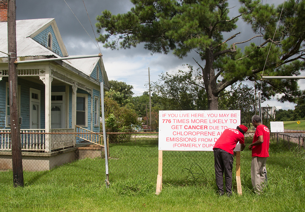 Concerned Citizens of St Jophn the Baptist puting up signs in Reserve, Louisiana. July 16, 2017