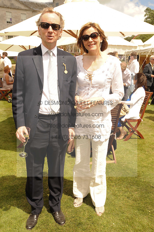 The EARL & COUNTESS OF WOOLTON at a luncheon hosted by Cartier for their sponsorship of the Style et Luxe part of the Goodwood Festival of Speed at Goodwood House, West Sussex on 4th July 2010.