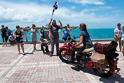 Andrea Labarbara riding her 1934 Indian 4-cylinder over the finish line during the Cross Country Chase motorcycle endurance run from Sault Sainte Marie, MI to Key West, FL. (for vintage bikes from 1930-1948). The Grand Finish in Key West's Mallory Square after the 110 mile Stage-10 ride from Miami to Key West, FL and after covering 2,368 miles of the Cross Country Chase. Sunday, September 15, 2019. Photography ©2019 Michael Lichter.