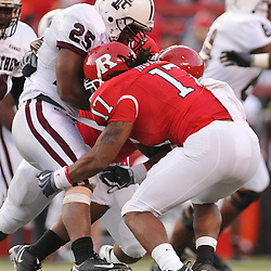 Oct 10, 2009; Piscataway, NJ, USA; Rutgers linebacker Damaso Munoz (17) tackles Texas Southern running back Martin Gilbert (25) during second half NCAA college football action in Rutgers' 42-0 victory over Texas Southern at Rutgers Stadium.