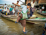 27 OCTOBER 2015 - YANGON, MYANMAR: A man gets off a cross river ferry at Aungmingalar Jetty in Yangon. The jetty is one of the numerous crossing points that bring people from the suburbs on the other side of the river into Yangon.    PHOTO BY JACK KURTZ