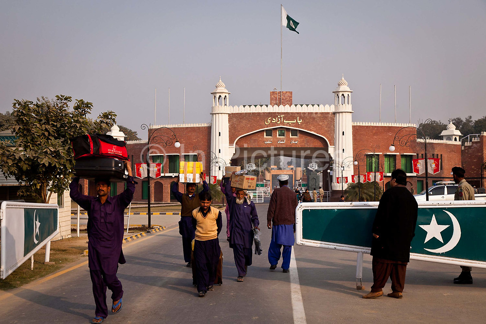 Pakistani nationals cross back into Pakistan at the Wagah border crossing, the only one of its kind across the vast expanse of the country's mutual territorial seperation with India.