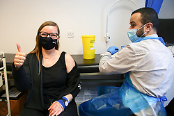 © Licensed to London News Pictures. 29/05/2021. London, UK. A woman gestures after pharmacist Huseyin Akpinar administered the AstraZeneca vaccine to her, at a Covid-19 vaccination centre in Tottenham, north London. Public Health England data shows that just under 7,000 cases of the Indian variant have been confirmed in the UK. Photo credit: Dinendra Haria/LNP