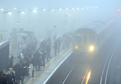 © Licensed to London News Pictures. 15/11/2012.Commuters at Pettswood Train station in the borough of Bromley, Kent, South East London border are traveling to work in the fog this morning as temperatures drop in the South East..Photo credit : Grant Falvey/LNP