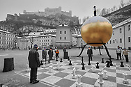 Unreliable Sightings - Saltzburg is a selective colour photography series by photographer Paul Williams  of men playing at a giant chess board taken in the snow in a Saltzburg square in 2008 . .<br /> <br /> Visit our REPORTAGE & STREET PEOPLE PHOTO ART PRINT COLLECTIONS for more wall art photos to browse https://funkystock.photoshelter.com/gallery-collection/People-Photo-art-Prints-by-Photographer-Paul-Williams/C0000g1LA1LacMD8