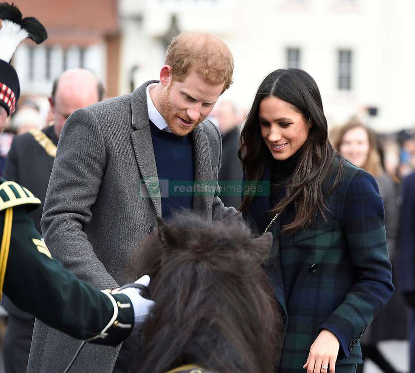 Prince Harry and Meghan Markle meet regimental mascot Cruachan IV during a walkabout on the esplanade at Edinburgh Castle, while on their visit to Scotland.