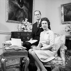 File photo dated 20/11/72 of Queen Elizabeth II and the Duke of Edinburgh celebrating their Silver Wedding Anniversary in the Belgian suite in Buckingham Palace. The Royal couple will celebrate their platinum wedding anniversary on November 20.