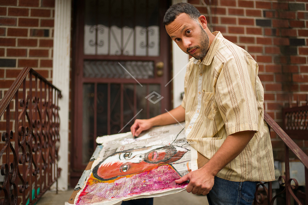 NEW YORK, NY – OCTOBER 29, 2013: Art therapist Kevin Ramirez at his home in The Bronx.  <br /> <br /> Photo by Robert Caplin