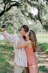 man and woman taking a photograph of themselves out in the countryside of South Carolina