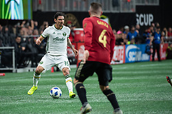 December 8, 2018 - Atlanta, Georgia, United States - Portland Timbers defender ZAREK VALENTIN (16) brings the ball upfield while Atlanta United defender GREG GARZA (4) looks on during the MLS Cup at Mercedes-Benz Stadium in Atlanta, Georgia.  Atlanta United defeats Portland Timbers 2-0 (Credit Image: © Mark Smith/ZUMA Wire)
