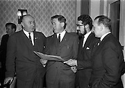 23/03/1963<br /> 03/23/1963<br /> 23 March 1963<br /> Gaelic Sports Journalists Association Presentation off Awards at the Anchor Hotel, Dublin. Present in the image are: Mr. Hugh Byrne, President of the G.A.A. (left); Minister for Social Welfare, Kevin Boland and  film director Louis Marcus (2nd from right).