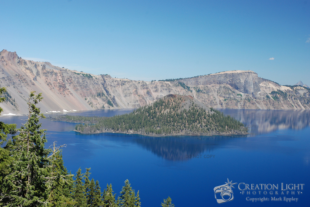 Crater Lake is located in Southern Oregon on the crest of the Cascade Mountain range. It lies inside a caldera, or volcanic basin, created when the 12,000 foot (3,660 meter) high Mount Mazama collapsed during a violent eruption...Crater Lake has a depth of 1,943 feet (592 meters) and is the seventh deepest lake in the world and the deepest in the United States. Crater Lake receives on average 533 inches of snow each year which supplies the lake with with water. There are no inlets or outlets to the lake. Evaporation and seepage prevent the lake from becoming any deeper.