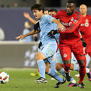 NEW YORK, NEW YORK - November 06:  Jozy Altidore #17 of Toronto FC challenges Andoni Iraola #51 of New York City FC during the NYCFC Vs Toronto FC MLS playoff game at Yankee Stadium on November 06, 2016 in New York City. (Photo by Tim Clayton/Corbis via Getty Images)