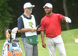July 15, 2018 - Silvis, Illinois, U.S. - SILVIS, IL - JULY 15:  Harold Varner III talks to his caddy about the best way to play his second shot on the #6 hole during the final round of the John Deere Classic on July 15, 2018, at TPC Deere Run, Silvis, IL.  (Photo by Keith Gillett/Icon Sportswire) (Credit Image: © Keith Gillett/Icon SMI via ZUMA Press)