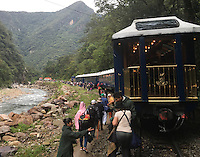 CUSCO, PERU - CIRCA OCTOBER 2015:  Inca Rail Trains and tourists close to Ciudad Machu Picchu