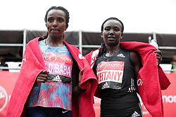 Kemnya's Mary Keitany (right) celebrates winning the Women's Virgin Money London Marathon alongside second placed Ethiopia's Tirunesh Dibaba. PRESS ASSOCIATION. Picture date: Sunday April 23, 2017. See PA story ATHLETICS Marathon. Photo credit should read: Yui Mok/PA Wire