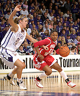Western Kentucky guard Ashley Butler (R) dirves into the paint against Kansas State's Danielle Zanotti (L), during the first half of the WNIT Semifinals at Bramlage Coliseum in Manhattan, Kansas, March 28, 2006.  The Lady Toppers lead K-State at halftime 24-23.