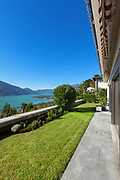 Architecture, nice terrace with green lawn, lake view