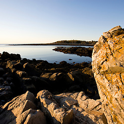 early morning on the rocky coast of Timber Point in Biddeford, Maine.  Atlantic Ocean.