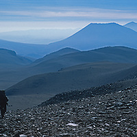 An archaeology expedition led by Dr. Johan Reinhard hikes up the slopes of 22,110-foot Volcan Llullaillaco in northern Argentina, where the team later found the world's highest mummies from an ancient Inca sacrifice.  Behind are lonely mountains of the vast South American Altiplano.