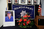 A portrait of Mohammad Reza Sadeghzadeh, a 67-year-old Milpitas 7-Eleven night clerk who was murdered on September 8, 2012 during a 2:13 a.m. robbery, is displayed during a press conference at the Milpitas Police Department in Milpitas, California, on December 12, 2013. (Stan Olszewski/SOSKIphoto)