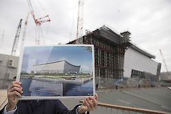 BEIJING, Feb. 13, 2019  A staff member shows a design sketch of Ariake Arena, one of the Tokyo 2020 Olympic Games venues, at Ariake Arena construction site in Tokyo, Japan, Feb. 12, 2019. This venue for volleyball games has been finished 51 percent of the construction work till the end of last month. (Credit Image: © Xinhua via ZUMA Wire)